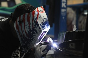 Welding_with_VIKING_helmet_at_inside_west_coast_customs