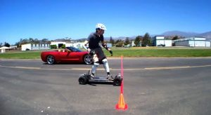 Video: Watch this Electric Skate Board Take on a Corvette in a Race