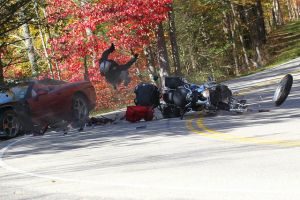 Unbelievable Motorcycle vs. Corvette Crash Caught On Camera