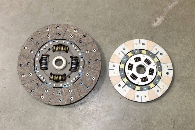 On the left side is the OEM LS7 clutch disc. While the stock clutch does a fantastic job of holding the original 505 crank horsepower, our application will eventually require us to upgrade to a smaller, lighter, and stronger assembly, like our new Mantic clutch disc on the right.