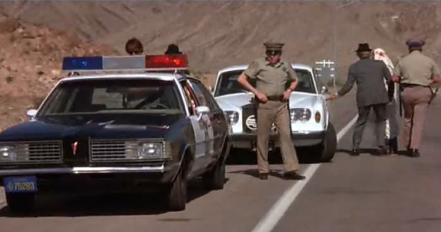 Avoiding the police while breaking the 55mph speed limit is the name of the game in The Cannonball Run.